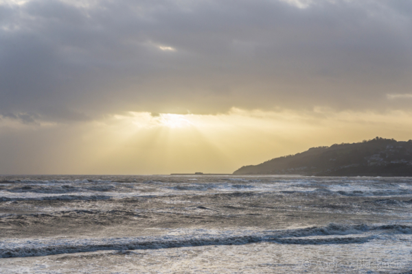 Stormy-cloudscape-&-sunrays-over-rough-sea-from-Charmouth-seafront-01_02_14-7