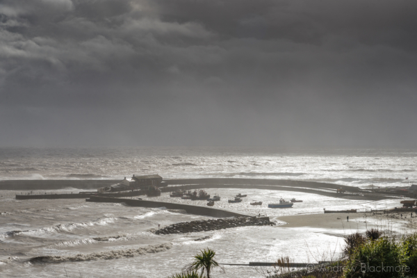 Stormy-seas-and-cloudscape-over-the-harbour-from-Langmoor-Gardens,-Lyme-Regis-05_02_14