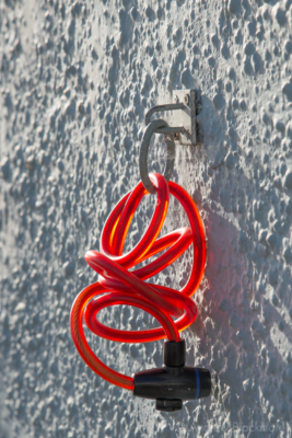 Sunlit-bicycle-lock-on-wall-Bell-Cliff,-Lyme-Regis-04_10_12