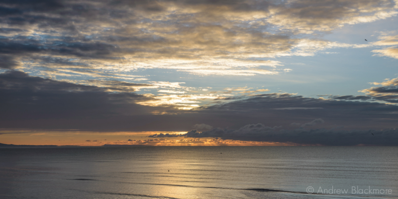 Sunrise-over-Lyme-Bay-from-The-Sundial,-Lyme-Regis-22_11_15-1-pan