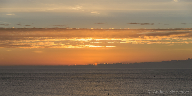 Sunrise-over-Lyme-Bay-from-The-Sundial,-Lyme-Regis-23_11_15-1-pan