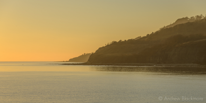 Sunset-over-the-sea-from-the-Cobb,-Lyme-Regis-29_12_14-5-pan