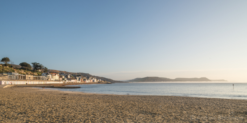 The-seafront-and-coast-with-sea-mist-from-Main-Beach,-Lyme-Regis-09_11_14-pan