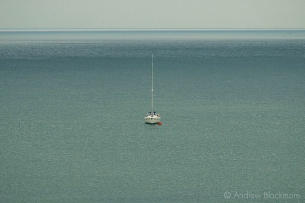 Yacht-(head-on)-on-calm-sea-in-Lyme-Bay-26_07_04