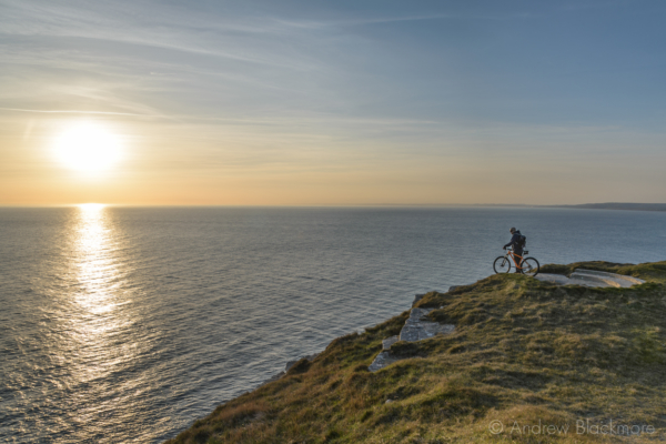 Portland-low-sun-from-West-Weare-cliffs-with-cyclist-22_03_15