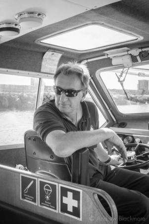 Portland-skipper-Steve-in-Pilot-Boat-Rodwell-(by-Outer-Breakwater)-26_08_16-2-b&w