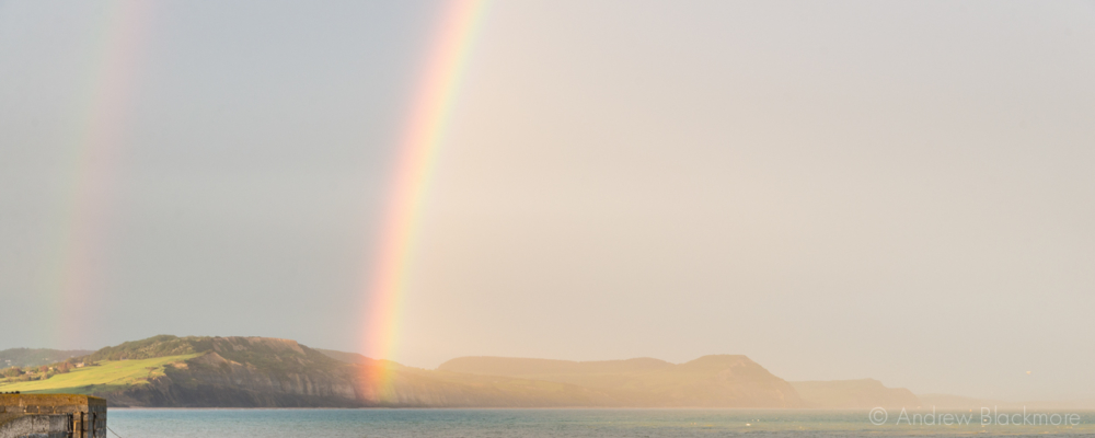 Rainbow-over-Charmouth-cliffs-from-Cobb-Gate,-Lyme-Regis-22_05_14-1-pan
