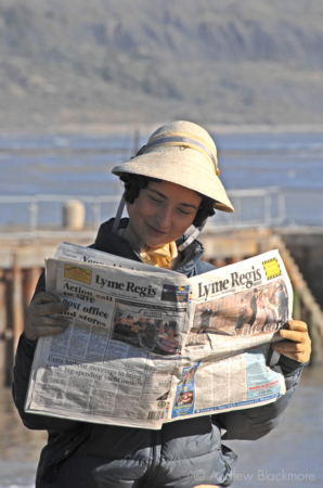 Rosamund-Stephen-reading-the-Lyme-News-filming-Jane-Austens-Persuasion-Lyme-Regis-20_10_06-2