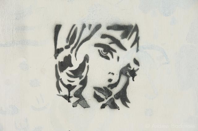 Stencil-graffiti-of-womans-face-Lyme-Regis-Promenade-26_12_07