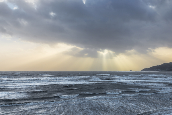 Stormy-cloudscape-&-sunrays-over-rough-sea-from-Charmouth-seafront-01_02_14-1