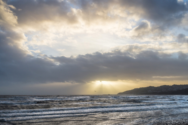 Stormy-cloudscape-&-sunrays-over-rough-sea-from-Charmouth-seafront-01_02_14-6