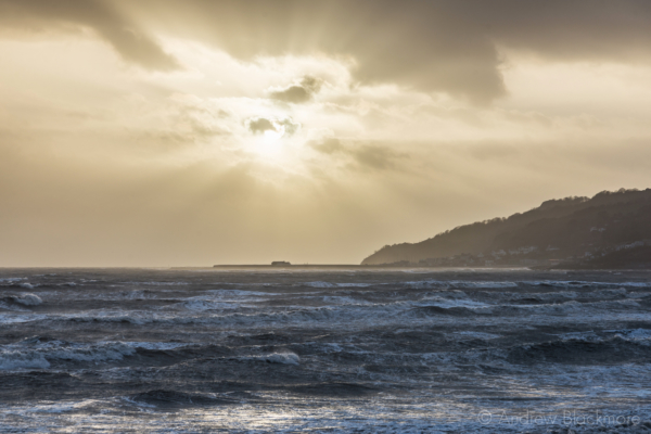 Stormy-cloudscape-&-sunrays-over-rough-sea-from-Charmouth-seafront-01_02_14-8