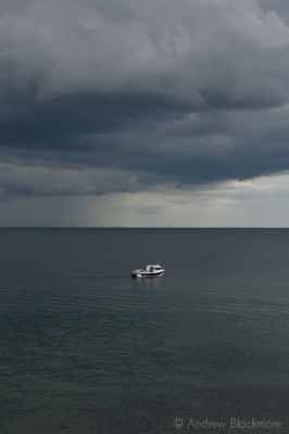 Stormy-cloudscape-and-boat-from-Cobb-Gate,-Lyme-Regis-20_07_07