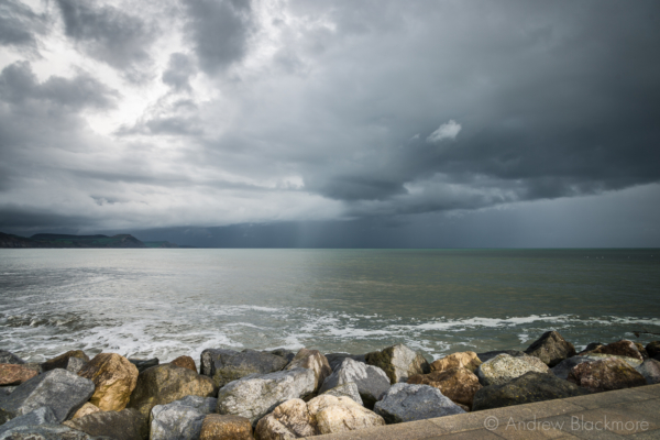 Stormy-cloudscape-and-evening-sun-from-Cobb-Gate-Beach,-Lyme-Regis-27_04_14-1