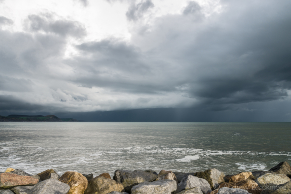 Stormy-cloudscape-and-evening-sun-from-Cobb-Gate-Beach,-Lyme-Regis-27_04_14-4