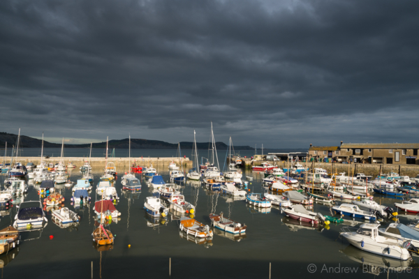 Stormy-cloudscape-and-sunlit-boats-in-the-harbour,-Lyme-Regis-26_09_14-1