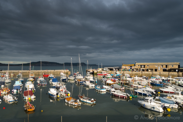 Stormy-cloudscape-and-sunlit-boats-in-the-harbour,-Lyme-Regis-26_09_14-2