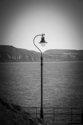 Street-lamp-and-coast-view-Church-Cliff,-Lyme-Regis-04_10_12-b&w
