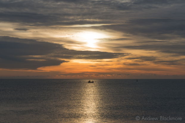 Sunrise-(and-fishing-boat)-from-Cobb-Gate-Beach,-Lyme-Regis-30_11_12