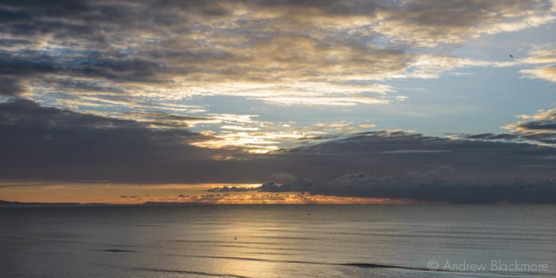 Sunrise-over-Lyme-Bay-from-The-Sundial,-Lyme-Regis-22_11_15-1-pan