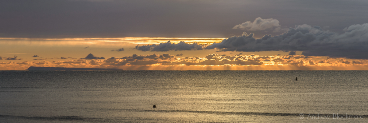 Sunrise-over-Lyme-Bay-from-The-Sundial,-Lyme-Regis-22_11_15-3-pan