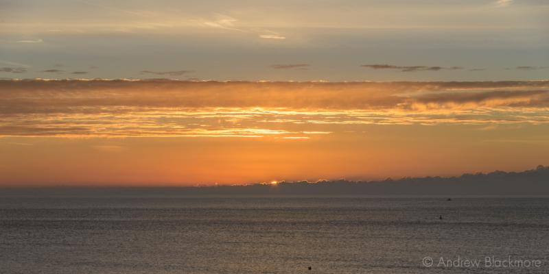 Sunrise-over-Lyme-Bay-from-The-Sundial,-Lyme-Regis-23_11_15-1-pan
