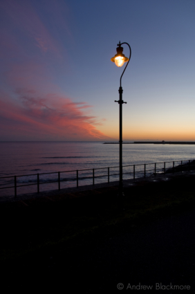 Sunset-and-lamp-from-Church-Cliff-Beach,-Lyme-Regis-25_12_07