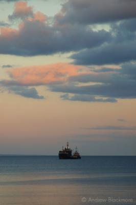 Supply-boat-at-dusk-from-Cobb-Gate,-Lyme-Regis-30_05_06