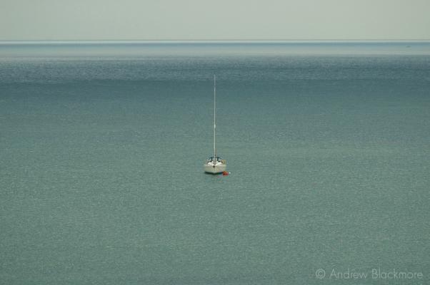 Yacht-(head-on)-on-calm-sea-in-Lyme-Bay-26_07_04